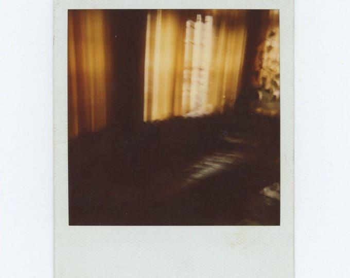 Vintage SX70 Polaroid Snapshot Photo: Leather Couch (78599)