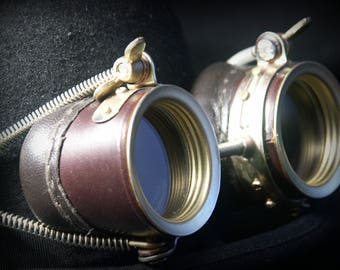 Steampunk goggles in dark brown leather and brass with wrapped wire decoration.