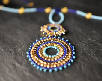 A Beautiful Blue and Gold Necklace made with Czech glass crystals, seed beads, gold tone copper elements, Circular brickstitched