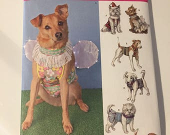 Sewing pattern.  Dog costumes.  Dog costume pattern. Simplicity pattern.  Dog's tuxedo. Sewing supply.  Santa costume. Halloween pattern.