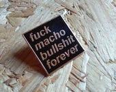 F**k Macho Bullshit Forever enamel pin in gold and black