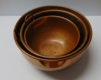 Nesting Set of 3 Copper Mixing Bowls with Hangers, 7.5 6.5 & 5.5 inches across.