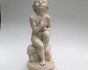 Child sitting on stone nude statue Skate 36 X 13 Cm