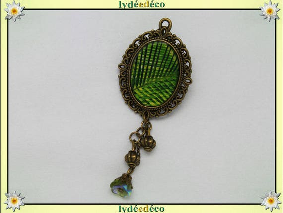Tanned lace retro shades of green yellow bronze resin and Pearl brooch