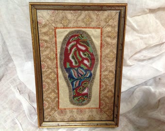 Antique beaded shoe form framed in Chinese silk unusual