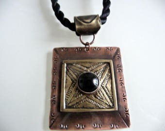 Ethnic pendant, copper and brass