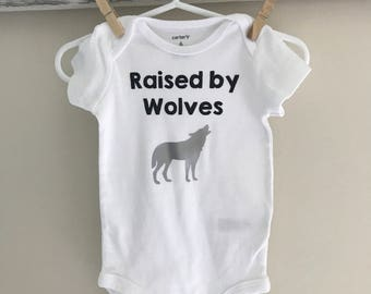 Free shipping* Raised by Wolves onesie