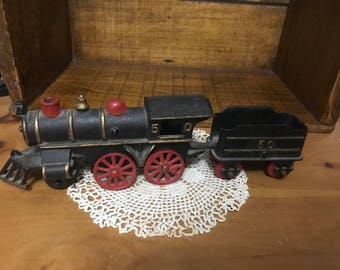 Vintage cast iron train and Cole cart.