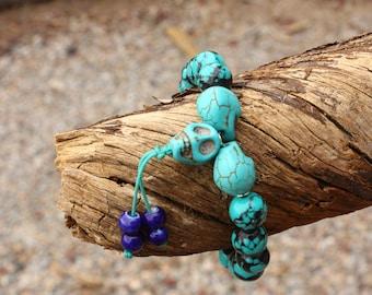 Turquoise and skull wrist mala