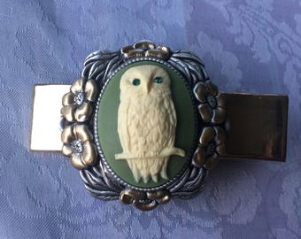 Owl cameo with sparkling green gem eyes.