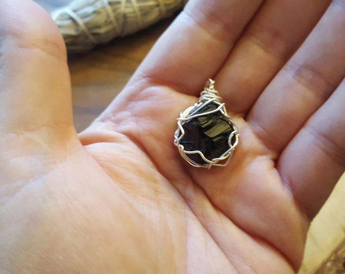 Black Tourmaline in silver plated copper wire wrapped pendant, Reiki infused approx 1x.7 inches (WW29)