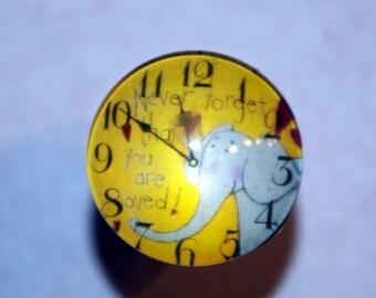 Dresser clock elephant button