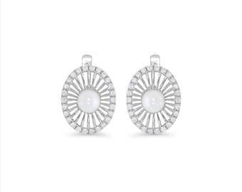 14k solid white gold diamond and pearl earrings.
