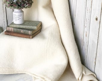 A lovely vintage ivory wool blanket