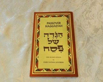 """The Passover Haggadah  book.New Revised Edition by Rabbi Nathan Goldberg. 1993. Size: 8 1/4""""H  x 5 1/4"""". English and Hebrew."""