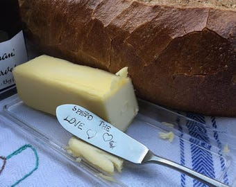"""Recycled butter knife hand stamped with the words """"Spread The Love Great gift with home made jam!"""