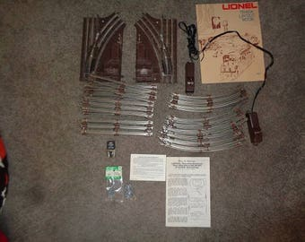 Lionel electric trains 027 gauge track,remote switches,power clip  nice shape