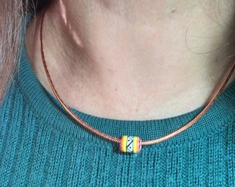 Cord necklace with a Peruvian ceramic