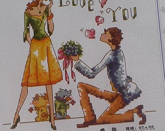 Set of cross stitch counted depicting a couple, romantic scene