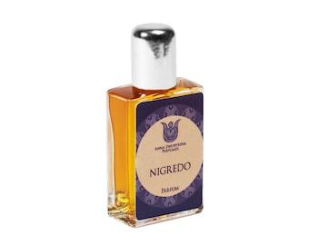 Nigredo - Natural perfume,  woody-balsamic, with spikenard, frankincense, cognac, vanilla, osmanthus,  agarwood, orris,   patchouli Flacon.