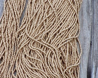 Silk gold seed beads , size 11 gold beads , glass seed beads