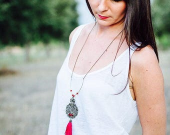 Long necklace bronze beads and Red tassel