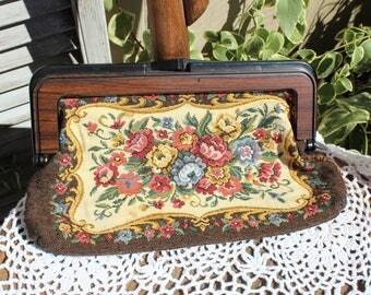Vintage. Tapestry/floral/fabric/pink/brown/plastic handle/wood color handle. Beautiful bag/clutch/handbag. Pretty floral!