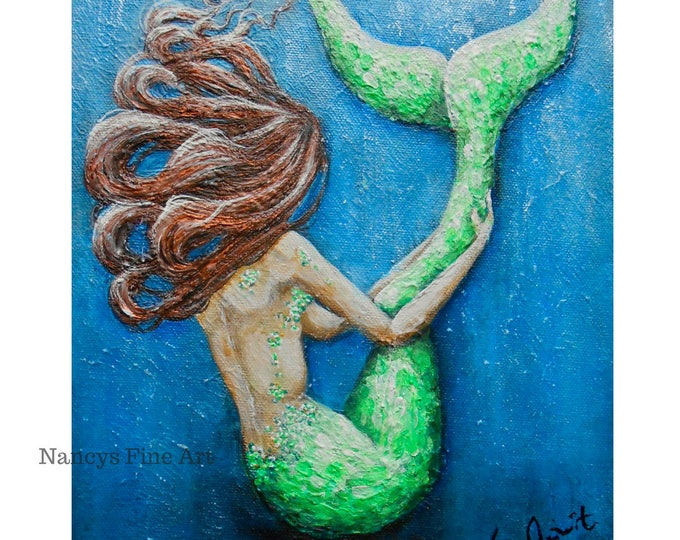 Little mermaid wall art, unique mermaid art, green mermaid artwork with red hair by Nancy Quiaoit.