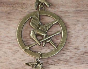 Solitaire ring, bronze mocking bird