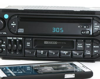 Chrysler Jeep 98-02 AMFM CD Cassette Player w Bluetooth Music Upgrade Part Number P04858540 Twin RAZ