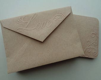 """20 embossed with """"Love"""" envelopes plus 20 flourish embossed cards to match"""