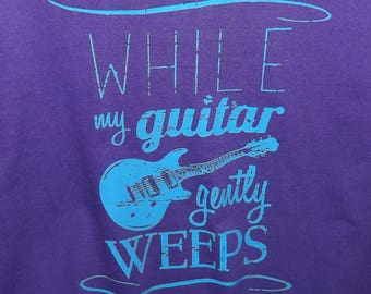 Original Typography Artwork Rock T-shirts. While My Guitar Gently Weeps Legendary Song of George Harrison. Unique Gift For Music Lovers.