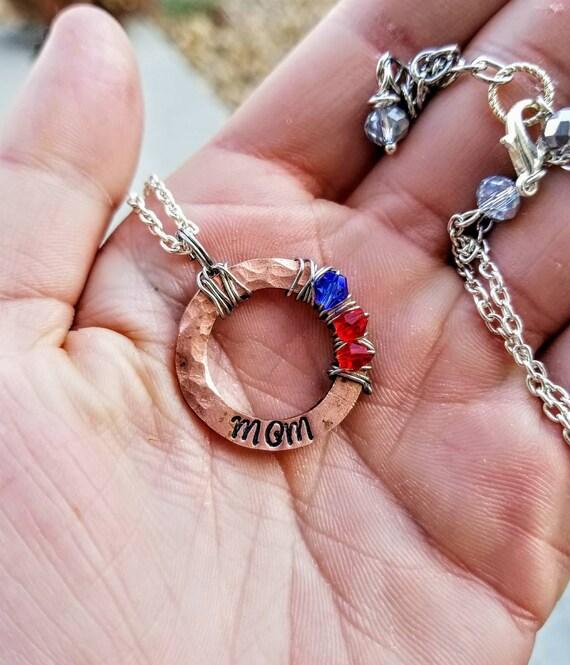 Mother's custom necklace. Children's birthstones
