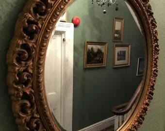 vintage round wooden framed mirror