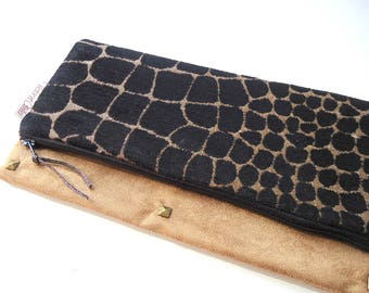 Hand folded in suede and velvet pouch