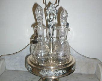 Antique Victorian silver plated Tantalus 5 crystal bottles cruet set c 1880