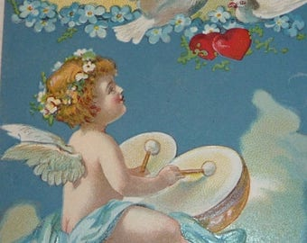 ON SALE till 7/28 Lovely Angel, Cherub Playing Drums in the Clouds, Doves and Hearts Antique Valentine Postcard