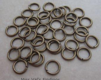 100 antique gold plated brass open split jumprings 18 gauge 7mm