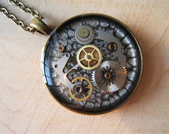 Steampunk necklace.  Handmade with genuine vintage cogs & watch parts. Resin pendant necklace.