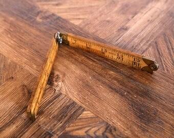 "Vintage folding timber & metal 24"" rule"