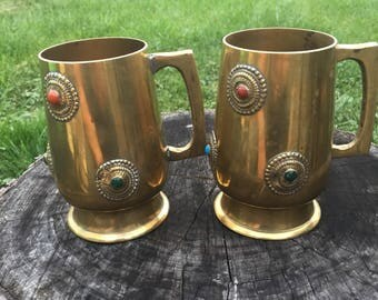 Vintage brass mugs with medalions