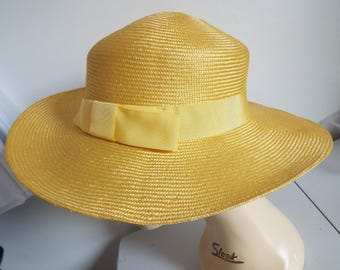 Vintage Ladies Yellow Straw Wide Brimmed Hat with Grosgrain banding and bow on side by Kangol