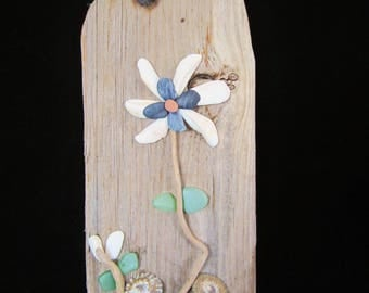 "Driftwood Art-white/blue shell flower, twisted stems, sea-tumbled green pebbles & glass. Measures 15"" x 5"" x 3/4"". Gift for any occasion!"