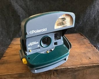 Vintage Polaroid camera One-Step Express green