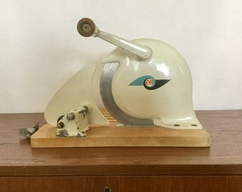 EVA meat slicer in cream, mounted on a wooden base with metal clamp. 1960's made in Denmark