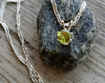 Small Genuine Round Peridot Gem in a sterling silver setting