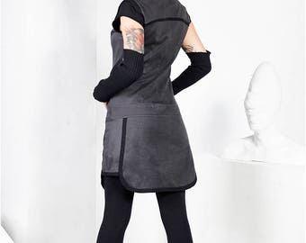 Dress with front zip and asymmetric skirt.