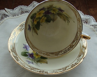 Royal Sutherland - Fine Bone China England - Vintage Tea Cup and Saucer - Purple and Yellow Violets on Pale Yellow with Gold Scroll and Trim