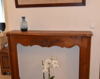 In solid cherry dressing of mantel decor mantel, decorative fireplace