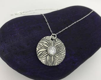 Silver Plumeria Pendant Necklace with Clear CZ